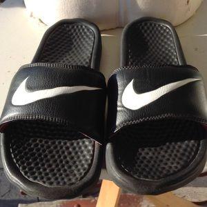 Womans Nike sliders.